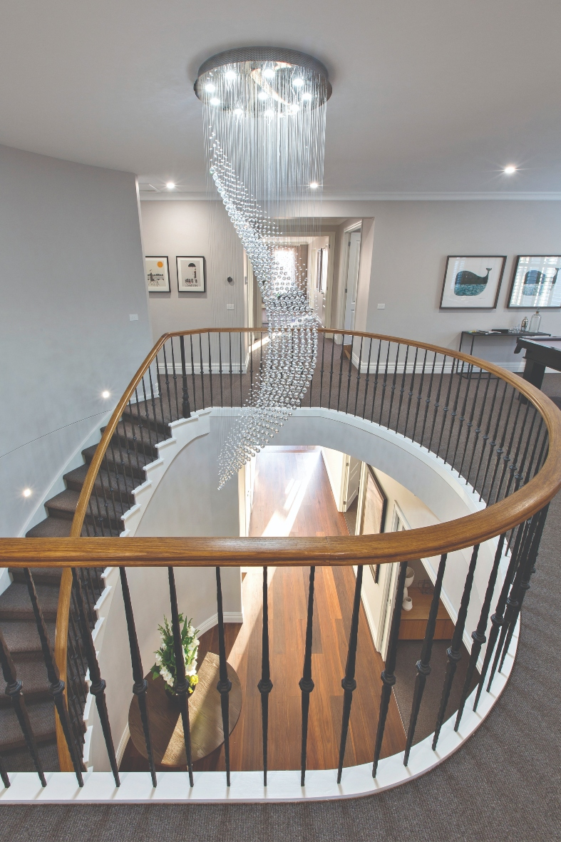 Marque's Rose Display home - image taken at top of staircase and features a decorative chandelier